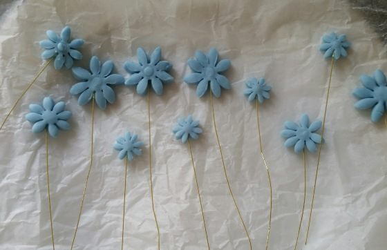 Flower Power - Drying out. The longer you're able to let them harden the easier it'll be to insert them into the cake.